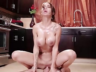 Beauty Sandee Westgate rides big dick in the kitchen