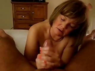 Mature Handjob #1 (On the Bed)