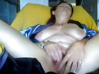 Beautiful mature woman masturbating her hairy pussy