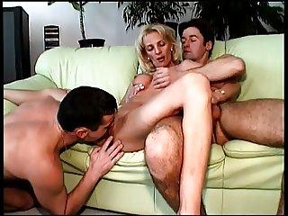 Naughty older blonde sexpot sucks off an assfucked bi guy