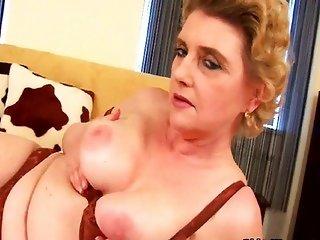Granny plays with a dildo