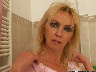 Busty mature mom fucks dildo