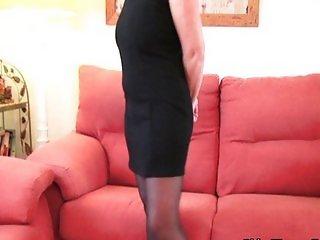 Classy grandma in stockings shows big tits