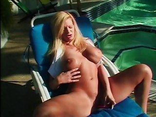 Big tit MILF stroking her twat