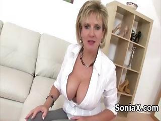Tempting mature rubbing creamy tits