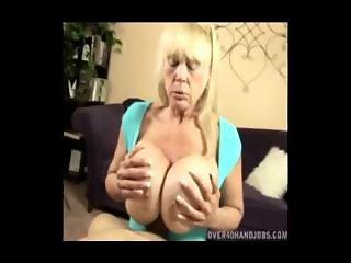 Mom squeezes dick between her monster boobs
