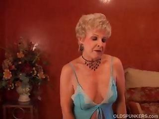 Mature blonde cougar puts on a slow striptease on her webcam