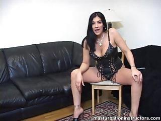 Fierce looking mistress demos jerk off process with legs spread