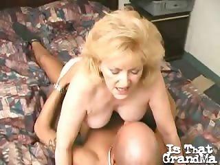 BUsty blobnde granny in stockings Kitty Fox fucks a giant cock in bedroom