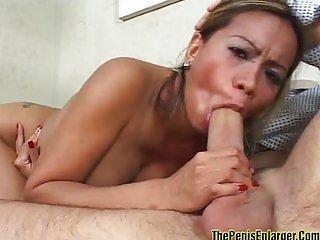 Asian babe does titfucking