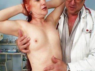 Mature Olga has her redhead hairy pussy gyno